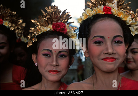 Young brightly dressed smiling Balinese dancers Photographed whilst waiting to perform Ubud Indonesia - Stock Photo