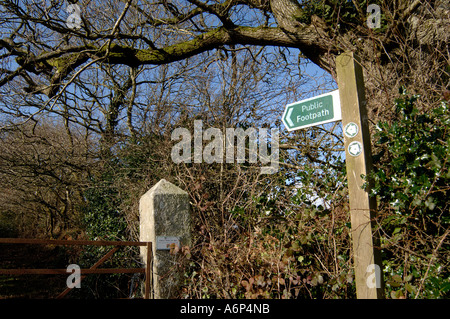 Footpath with metal gate sign and leafless trees in mid Devon in winter - Stock Photo