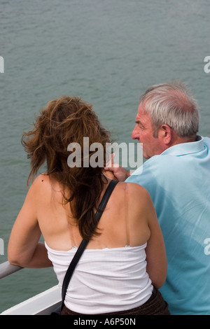 Couple male and female chatting whilst leaning on rails of ferry returning to England Boulogne sur Mer Pas de Calais - Stock Photo