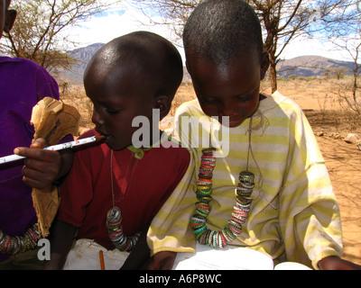 Malambo district in the Ngorongoro Crater of Tanzania, Africa. Photograph shows Maasai children - Stock Photo