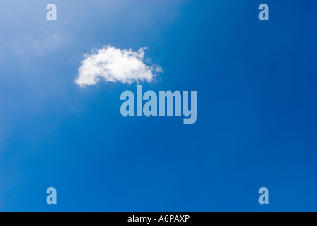 one single white soft fluffy cloud in blue sky - Stock Photo
