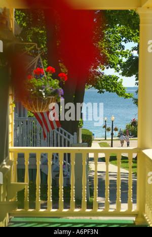 USA Michigan Lake Huron Mackinac Island front porches of homes along Market Street - Stock Photo