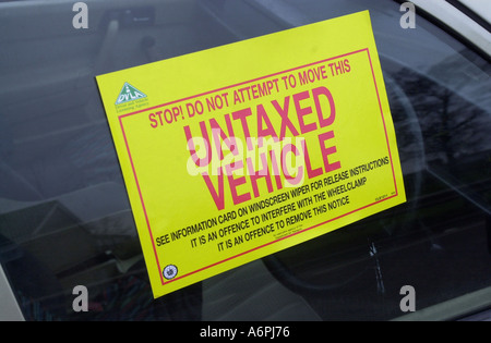 Warning sign for untaxed car about to be removed from a road in Luton UK - Stock Photo