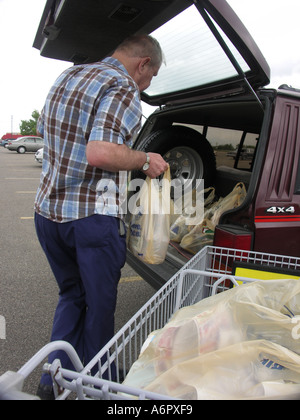 Loading Groceries into SUV - Stock Photo
