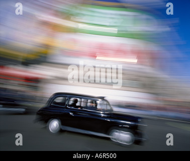 Black cab Picadilly Circus London - Stock Photo