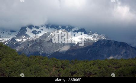 Yulong Jade Dragon Snow Mountain near Lijiang in Yunnan China - Stock Photo