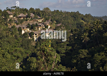 Luxury villa resort on the banks of the scenic Ayung River in Ubud in Central Bali - Stock Photo