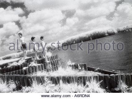 Three boys standing on a dock Holland - Stock Photo