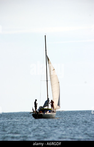 couple in small sailing yacht takes off - Stock Photo