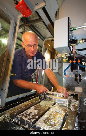portrait of worker with milling machine - Stock Photo