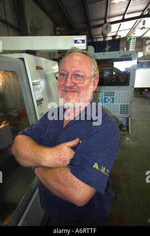 mature worker in metal workshop - Stock Photo