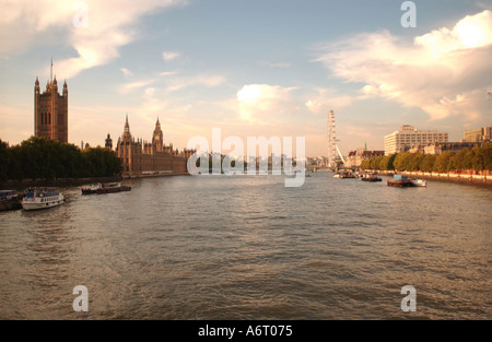 Houses of Parliament on the north bank of the River Thames and the London Eye on the South Bank. London. England. - Stock Photo