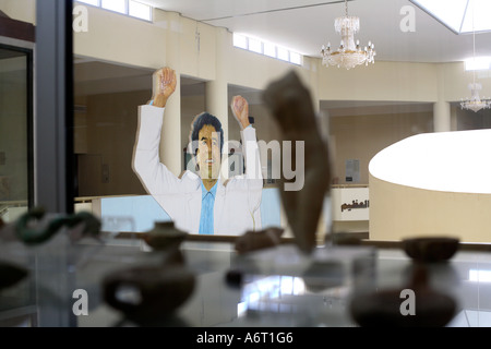 A giant poster of Libyan leader Colonel Gaddafi overlooks the  antiquities at Leptis Magna Museum in Libya - Stock Photo
