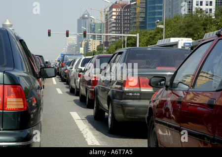 Long lines of cars wait during a traffic jam on a downtown highway in Beijing, China. - Stock Photo