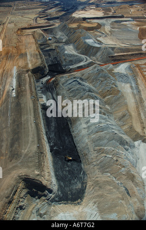 Aerial view open cut coal mine Central Queensland coal basin Australia grey black earth overburden dump waste - Stock Photo