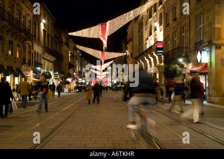 Christmas shopping on Cours de l intendance Bordeaux Gironde Aquitaine France Europe - Stock Photo