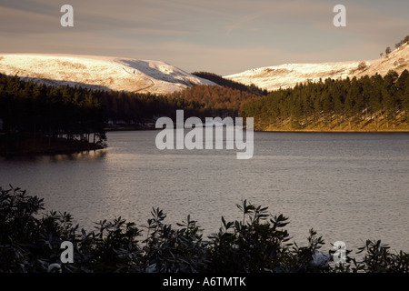 A wintry scene of Howden moors viewed from across Howden Dam in the Upper Derwent Valley in the Peak District National - Stock Photo