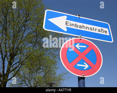 Traffic sign, stopping, restriction, one-way street - Stock Photo