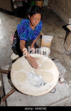 Maya woman baking tortillas, Chiapas, Mexico - Stock Photo