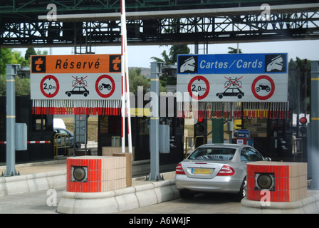 French motorway toll booths with car - Stock Photo