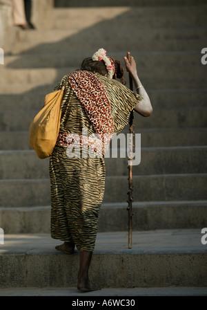 Asia Nepal Kathmandu November 2003 Pashupatinath. A sadhu (holy man) leaves the banks of the River Bagmati. - Stock Photo