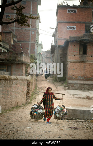 Asia Nepal Kathmandu November 2003 Rubbish is brought down to the Bishnumati river at dawn and dumped on the banks - Stock Photo