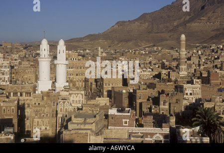 Yemen, Sana'a, Sunset over the old city of Sana'a with it's many mosques and minarets - Stock Photo