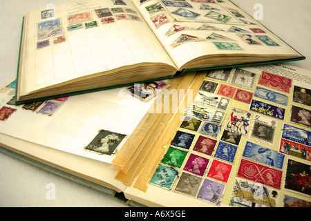 An open stamp album displaying a stamp collection - Stock Photo