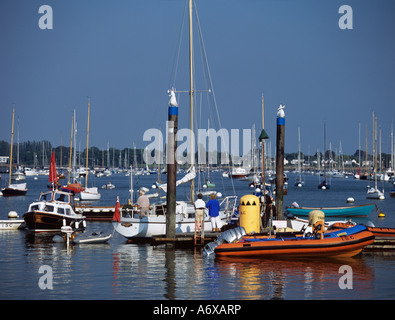 ITCHENOR WEST SUSSEX UK June A couple of women about to board a yacht in Chichester Harbour - Stock Photo