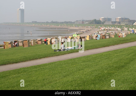 People walking on the bottom of the North Sea while low tide, in Buesum, Germany - Stock Photo