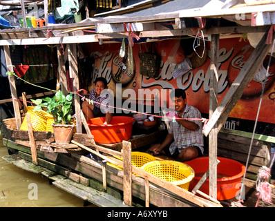 Bangkok Drying fish in the sun Chao Praya River - Stock Photo