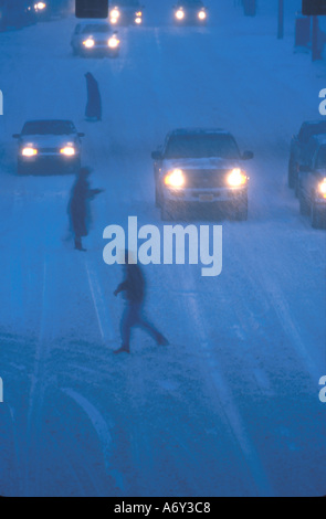 Traffic in Snowstorm on 6th Ave Anchorage SC AK - Stock Photo