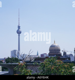 City skyline featuring the Television Tower and the New Synagogue Berlin Germany - Stock Photo