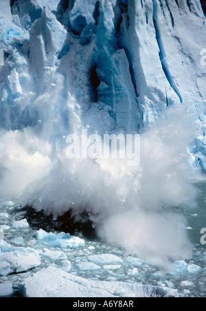 Ice breaking off a glacier - Stock Photo