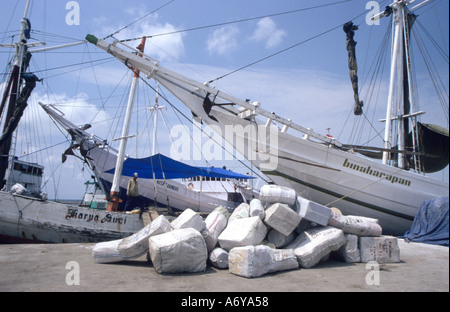 Indonesian port of Sunda Kelepa,Jakarta ,with bales of cargo waiting to be loaded onto the tradition Bugis pinisi - Stock Photo