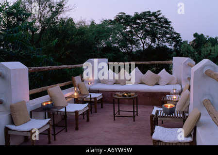 Seating area on the roof terrace of an old farm house conversion now a residential home Amber near Jaipur Rajasthan - Stock Photo