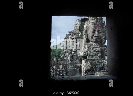 Enigmatic faces at the Bayon The central tower carved with gigantic heads faces towards the cardinal points Angkor - Stock Photo