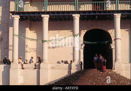 Local Maya townspeople from Santiago Atitlan departing the colonial church and relaxing outside Lake Atitlan Guatemala - Stock Photo
