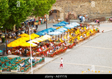 Cafes on the beach with colourful sun shade umbrellas. The beach in the village. Collioure. Roussillon. France. - Stock Photo
