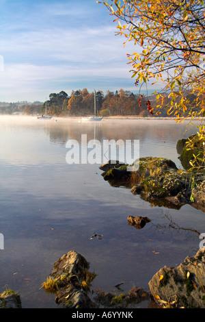 Morning mist on Lake Windermere Cumbria England - Stock Photo