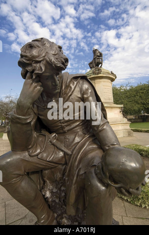 Statue of Hamlet with William Shakespeare behind Stratford upon Avon Warwickshire England United Kingdom Europe - Stock Photo