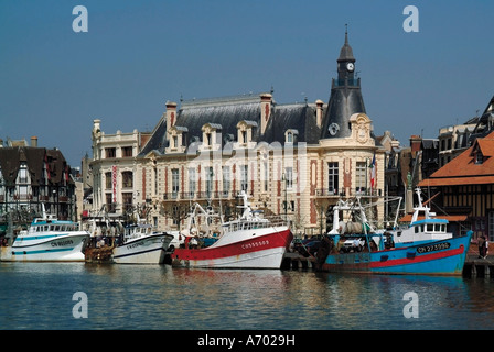 Hotel de Ville town hall and fishing boats at mouth of the River Touques Trouville Calvados Cote Fleurie Normandy - Stock Photo
