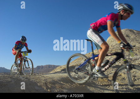 Two competitiors in the Mount Sodom International Mountain Bike Race Dead Sea area Israel Middle East - Stock Photo