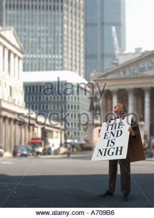 Sandwich board man in the city of London - Stock Photo