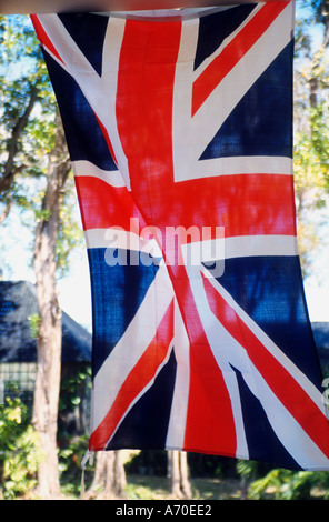 Union flag fluttering hanging vertically - Stock Photo