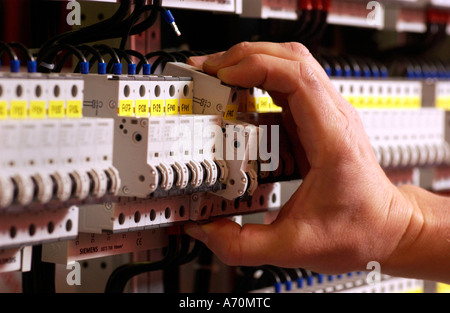 Building of switchgears in a school, Installations of the current distributor. Fuse box, electrical safety devices. - Stock Photo
