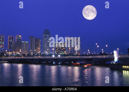 Full moon over Anderson Bridge and Singapore River - Stock Photo