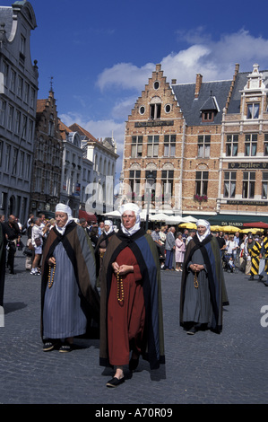 Europe, Belgium, Bruges, Ascension Day parade; Holy Day; locals in period costumes - Stock Photo