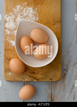 Eggs and flour on wooden background painted pale blue - high end Hasselblad 61mb digital image - Stock Photo