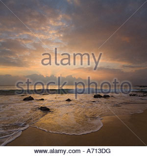 Sunset from Kamaole Beach on the island of Maui in the state of Hawaii USA - Stock Photo